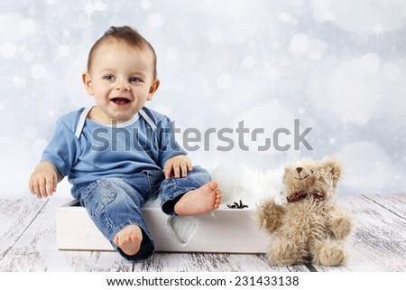 Little baby boy with plush teddy bear - stock photo