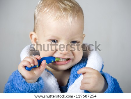 Little baby boy with tooth brush - stock photo