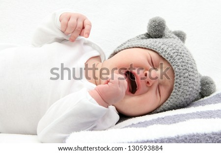 little baby crying on bed