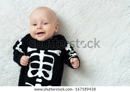 Little baby dressed funny skeleton