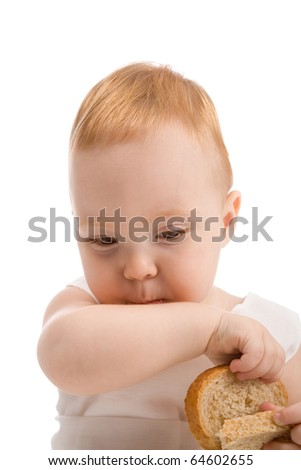 Little baby eating bread isolated on white