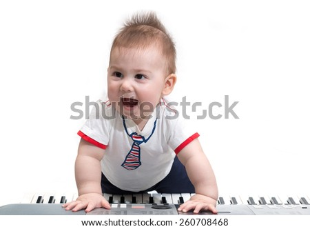 Little baby enjoying playing on piano (synthesizer), isolated on white - stock photo