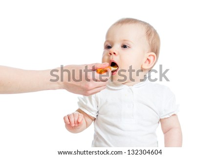 Little baby feeding with a spoon