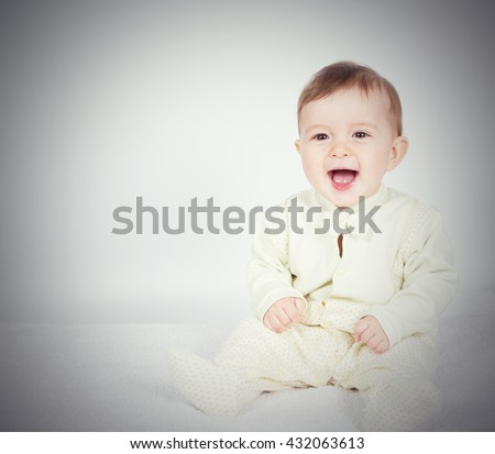 Little  baby funny boy in suit sitting. On white.