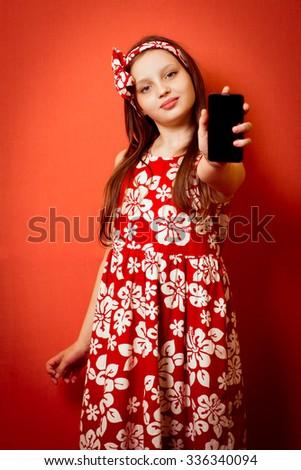 Little baby girl advertises phone - stock photo