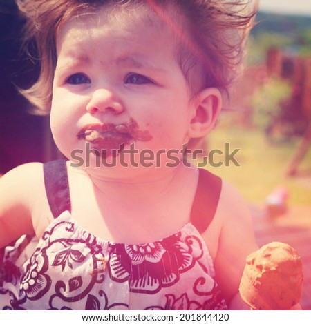 Little Baby girl eating ice cream - instagram effect - stock photo