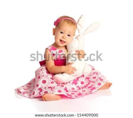 little baby girl hugging a  toy bunny rabbit isolated on white background - stock photo