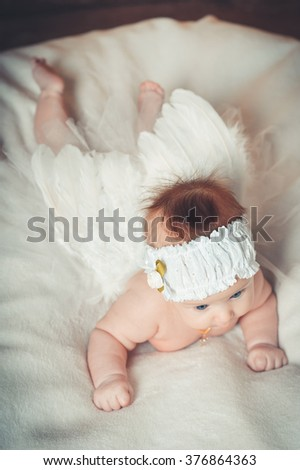 Little baby girl in tutu with angel wings