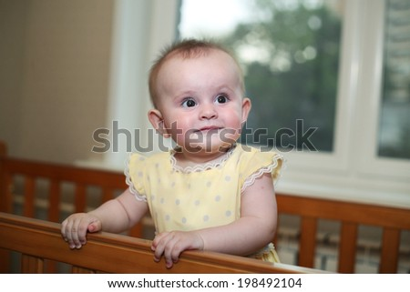 little baby girl in yellow dress close up portrait
