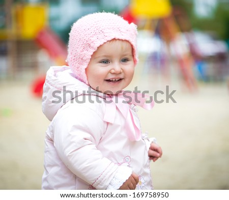 little baby girl on the playground - stock photo