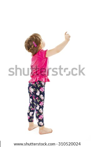 Little baby girl showing something above her, rear view. Isolated on white background  - stock photo