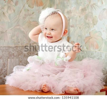 Little baby girl wearing beautiful dress - stock photo