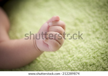 little baby hand holding - stock photo
