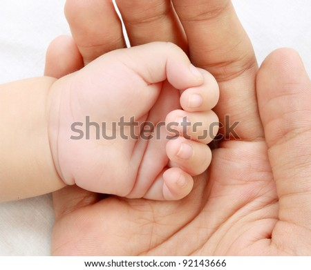 little baby hand with mother's hand - stock photo