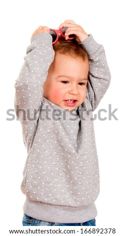 Little baby holding hands on her head isolated on white - stock photo