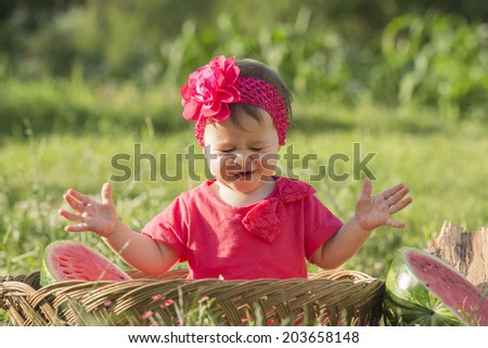 Little baby in basket holding watermelon , healthy lifestyle conceptual photo  - stock photo
