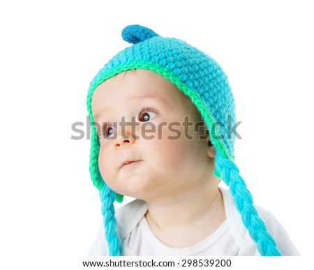 little baby in knitted dino hat - stock photo