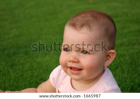 Little baby in the meadow - stock photo