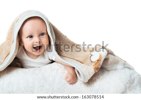 Little baby is laughing under the  biege carpet - stock photo