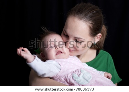 Little baby is with her mother. - stock photo