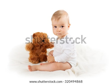 Little baby isolated on white background with teddy bear