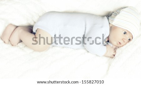 little baby lying in the bed