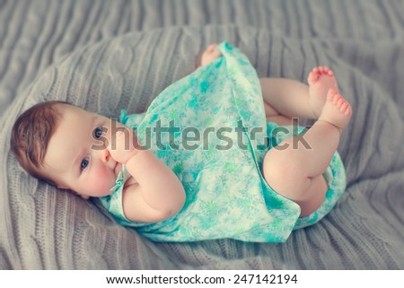 little baby lying on a blanket - stock photo