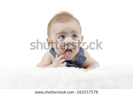 little baby lying on his belly looking up, isolated on white - stock photo