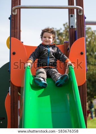 little baby playing in the park - stock photo