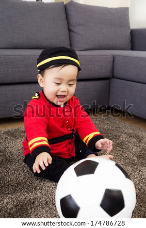 Little baby playing with football - stock photo