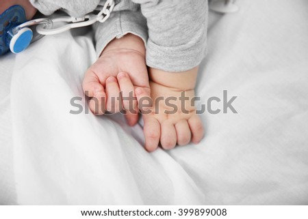 Little baby's hands, close up - stock photo