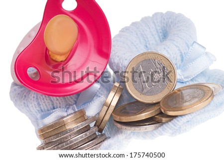 little baby shoes and euro coins and pacifier / Expenses for a child