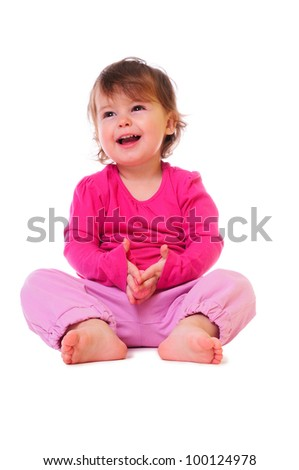 little baby sitting and smiling. pink clothing. isolated on white - stock photo