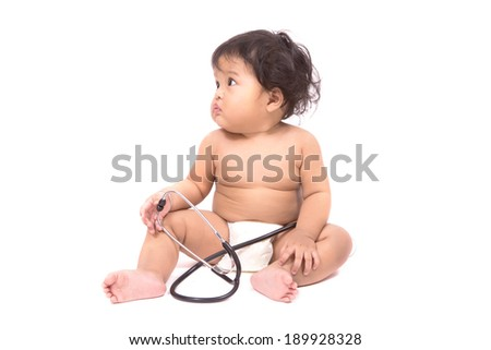 Little baby sitting on floor wearing and holding a stethoscope, isolated on white background