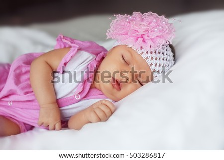 little baby sleeping in a bandage. The concept of newborn and family.