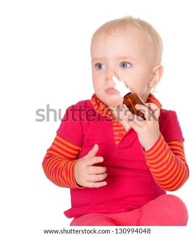 Little baby spraying herself nose spray isolated on white background