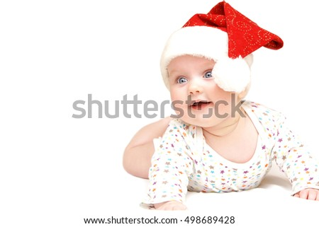 little baby wearing funny santas hat christmas decoration on white