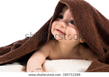Little baby with a brown towel