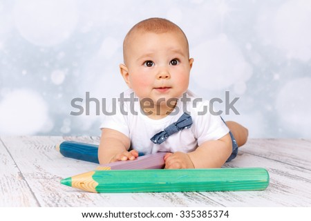 Little baby with big crayons