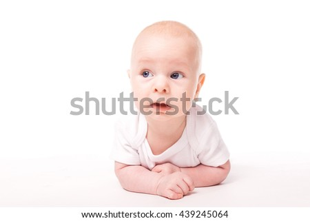 little baby with blue eyes dressed in white on a white background