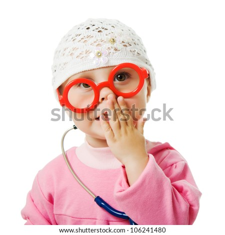 Little baby with glasses and with a stethoscope is a doctor on a white background. - stock photo