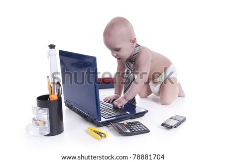Little baby with laptop on a white background