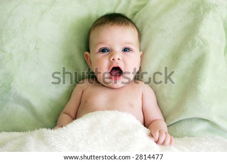 little baby with mouth open - stock photo