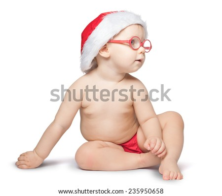 little baby with Santa hat and glasses sit on white  background. isolated - stock photo