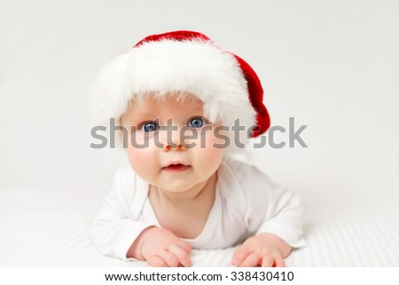 little baby with santas hat surprised - stock photo