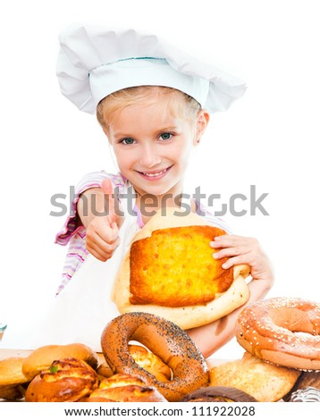 Little baker with thumbs up on a white background - stock photo