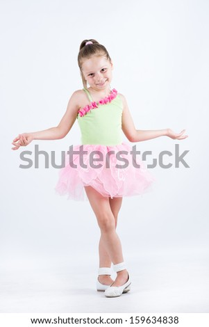 Little ballerina child arms open and smiling