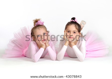 Little ballet dancers over white background - stock photo