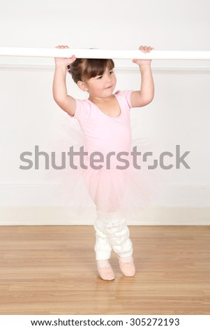 Little ballet girl dancing at the studio