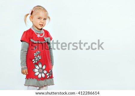 Little beautiful blond girl on a white background. Child looks slyly - stock photo